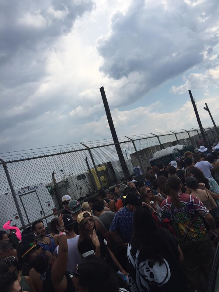 The long line for the BBQ and impending storm clouds - Photo Credit: Luke Tao